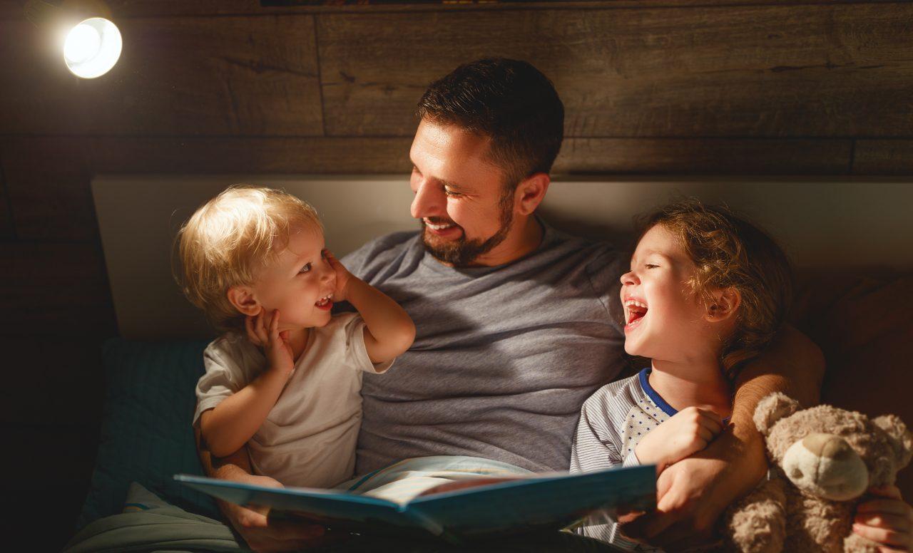 Dad reading bedtime boys